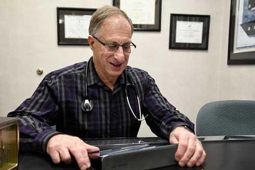 Photo of Dr. Barth at his desk