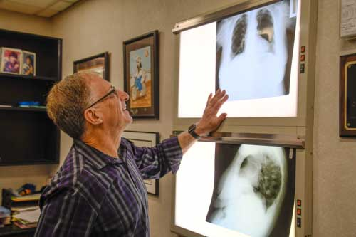 Photo of Dr. Barth looking at X-Rays