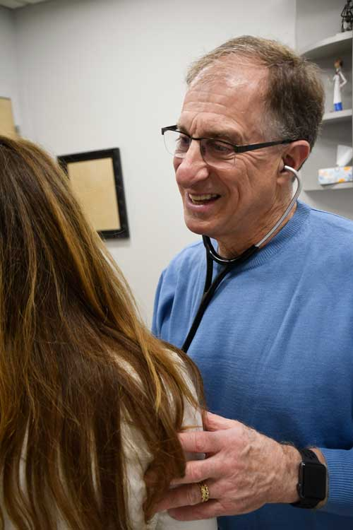 Image of Eric R. Barth, MD interacting with a patient